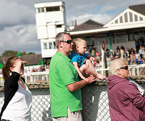 Family in the course enclosure